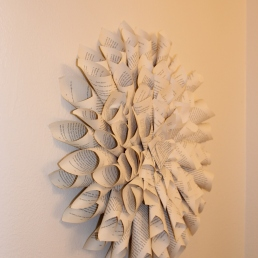 This is a wreath I made out of old book pages!